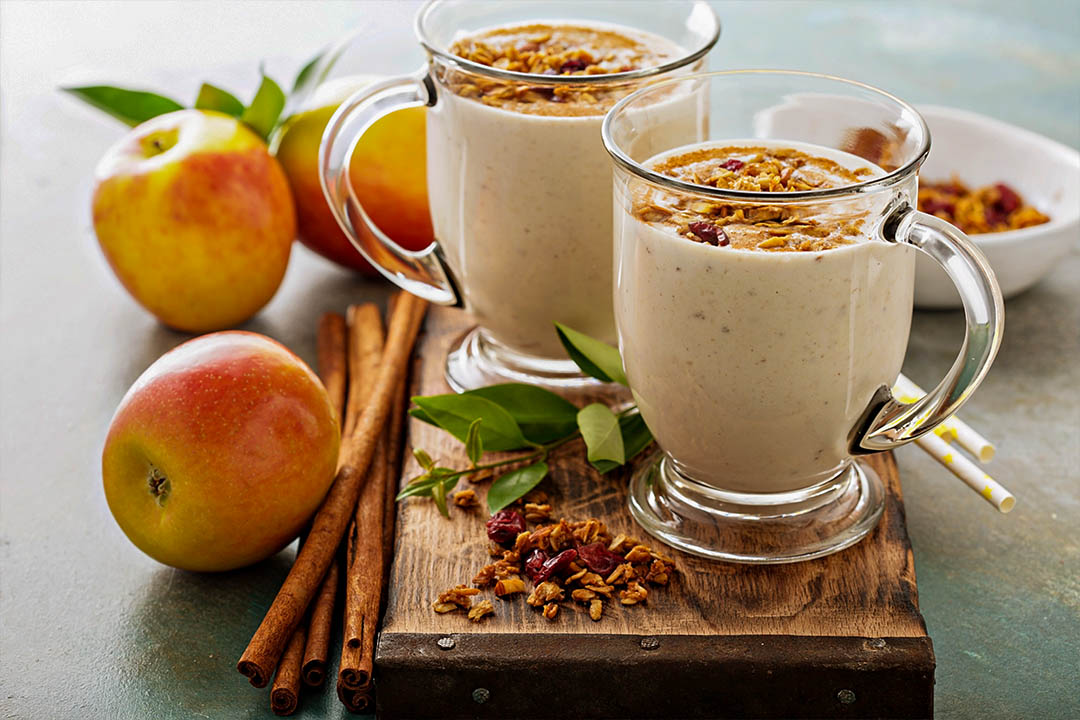 Picture of two apple pie smoothie with cinnamon and granola