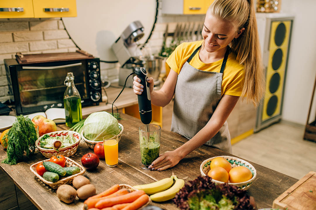 picture of Female person cooking, mixing healthy organic food